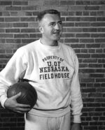 In this undated photo provided by the University of Nebraska-Lincoln, former Nebraska basketball coach Jerry Bush holds a basketball. Nebraska's current NCAA college basketball coach Fred Hoiberg is his grandson. Hoiberg said he wishes Bush could have seen him play college and pro basketball, and he would have loved to have talked about coaching with him. He keeps a scrapbook with newspaper clippings from the Bush era on a table in his office, and he said he feels a connection. (University of Nebraska Lincoln via AP)