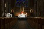 Cardinal Thomas Collins, the Catholic Archbishop of Toronto, performs a live-streamed mass at St. Michael's Cathedral in Toronto, on Wednesday March 25, 2020, after churches were closed due to the COVID-19 pandemic.(Chris Young/The Canadian Press via AP)
