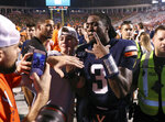 Virginia quarterback Bryce Perkins (3) celebrates with fans after Virginia defeated Florida State 31-24 during an NCAA college football game in Charlottesville, Va., Saturday, Sept. 14, 2019. (AP Photo/Andrew Shurtleff)