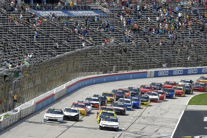 Drivers get the green flag to start a NASCAR Xfinity Series auto race at Texas Motor Speedway in Fort Worth, Texas, Saturday, June 12, 2021. (AP Photo/Larry Papke)