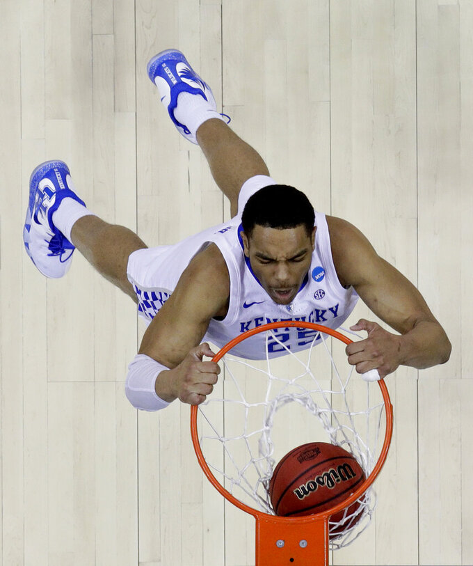 Kentucky's PJ Washington dunks the ball during the second half of the Midwest Regional final game against Auburn in the NCAA men's College basketball tournament Sunday, March 31, 2019, in Kansas City, Mo. Auburn won 77-71 in overtime. (AP Photo/Charlie Riedel)