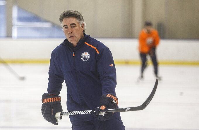 Edmonton Oilers' head coach Dave Tippett skates during training camp in Edmonton, Alta., on Tuesday July 14, 2020. (Jason Franson/The Canadian Press via AP)