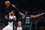 Orlando Magic's D.J. Augustin shoots in front of Boston Celtics' Kyrie Irving (11) during the first half of an NBA basketball game in Boston, Sunday, April 7, 2019. (AP Photo/Michael Dwyer)