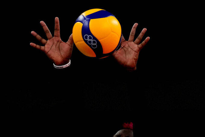 The hands of Kenya's Sharon Chepchumba Kiprono block the ball during the women's volleyball preliminary round pool A match between Dominican Republic and Kenya at the 2020 Summer Olympics, Saturday, July 31, 2021, in Tokyo, Japan. (AP Photo/Frank Augstein)