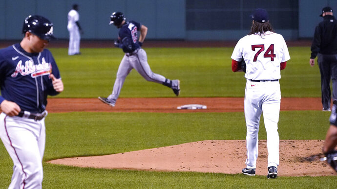 Boston Red Sox pitcher Mike Kickham (74) watches as Atlanta Braves' Adam Duvall, center, rounds the bases on Duvall's two-run home run during the second inning of a baseball game, Wednesday Sept. 2, 2020, in Boston. At left is Braves Austin Riley. (AP Photo/Charles Krupa)