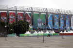 Banners showing players from the Los Angeles Chargers and the Kansas City Chiefs hang from Aztec Stadium, days before an NFL football game, Saturday, Nov. 16, 2019, in Mexico City. The Chargers face the Chiefs on Monday, Nov. 18. (AP Photo/Marcio Jose Sanchez)