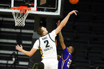 Iowa forward Jack Nunge (2) blocks a shot by Western Illinois forward Ramean Hinton (23) during the second half of an NCAA college basketball game, Thursday, Dec. 3, 2020, in Iowa City, Iowa. (AP Photo/Charlie Neibergall)