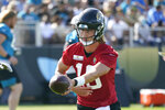 Jacksonville Jaguars quarterback Trevor Lawrence works on a hand-off drill during an NFL football practice, Friday, Aug. 6, 2021, in Jacksonville, Fla. (AP Photo/John Raoux)