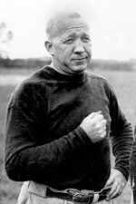 FILE - This is a 1925 file photo showing Notre Dame football coach Knute Rockne. Date and location are unknown.  No. 12 Notre Dame travels to Chicago this weekend to play No. 18 Wisconsin at Soldier Field. It is another chapter in the long history of connections between Chicago and Notre Dame athletics. The most famous coach in Fighting Irish history, Knute Rockne, was raised in Chicago. Dozens of Chicago natives have played for Notre Dame and a few have come home to play for the NFL's Chicago Bears. Current coach Brian Kelly has a chance this weekend to go ahead of Rockne as Notre Dame's winningest coach. (AP Photo/File)