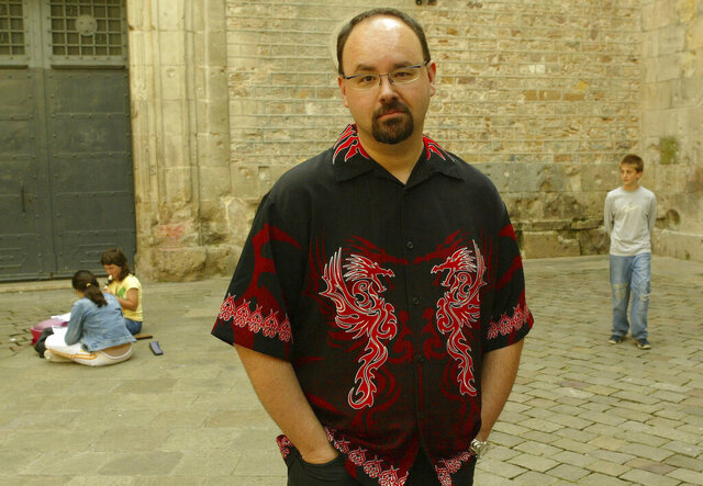 In this Wednesday, May 26, 2004 photo, writer Carlos Ruiz Zafon poses in the Sant Felip Neri Square in the center of Barcelona, Spain. Spanish writer Carlos Ruiz Zafon, author of the acclaimed