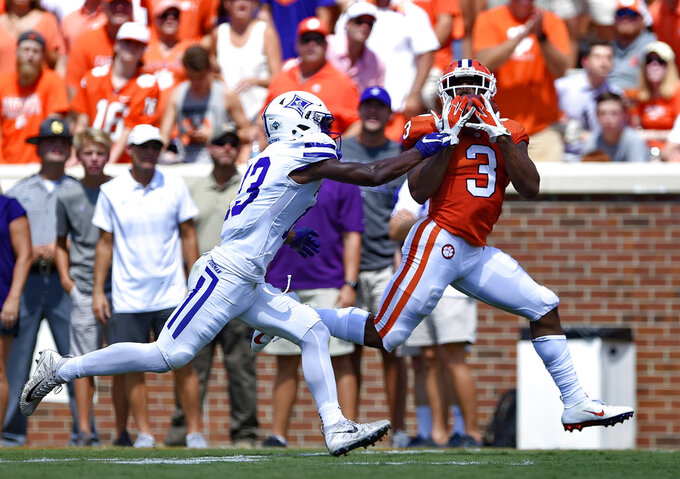Clemson's Amari Rodgers pulls in a reception for a touchdown while defended by Furman's Quandarius Weems during the first half of an NCAA college football game Saturday, Sept. 1, 2018, in Clemson, S.C. (AP Photo/Richard Shiro)