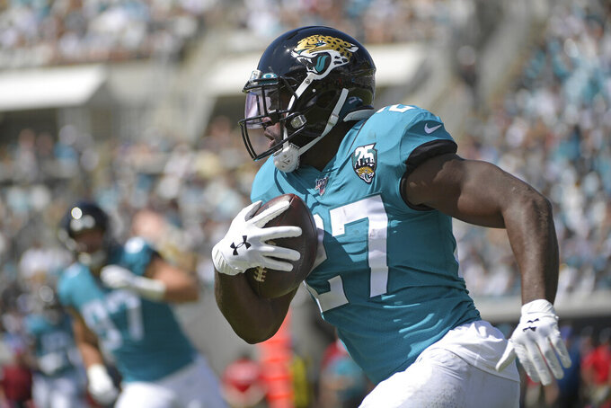 Jacksonville Jaguars running back Leonard Fournette runs against the New Orleans Saints during the first half of an NFL football game, Sunday, Oct. 13, 2019, in Jacksonville, Fla. (AP Photo/Phelan M. Ebenhack)