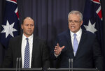 FILE - In this Aug. 24, 2018, file photo, Australia's next Prime Minister Scott Morrison, right, speaks next to Deputy Leader of the Liberal Party Josh Frydenberg during their press conference at Parliament House in Canberra. Australia. Saturday, May 18, 2019 is the last possible date that Morrison could have realistically chosen to hold an election. (AP Photo/Andrew Taylor, File)