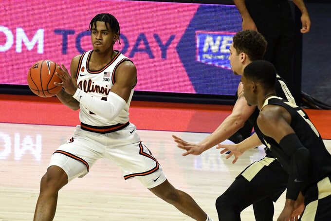 Illinois guard Adam Miller (44) passes the ball as Purdue's guard Brandon Newman (5) and forward Mason Gillis (0) defend in the first half of an NCAA college basketball game Saturday, Jan. 2, 2021, in Champaign, Ill. (AP Photo/Holly Hart)