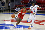 Houston guard Marcus Sasser (0) drives past SMU guard Kendric Davis (3) during the first half of an NCAA college basketball game in Dallas, Sunday, Jan. 3, 2021. (AP Photo/Roger Steinman)