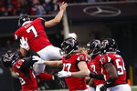 Atlanta Falcons kicker Younghoe Koo (7) jumps into Atlanta Falcons cornerback Isaiah Oliver (26) after Koo recovered a fumble against the Carolina Panthersduring the second half of an NFL football game, Sunday, Dec. 8, 2019, in Atlanta. (AP Photo/John Bazemore)