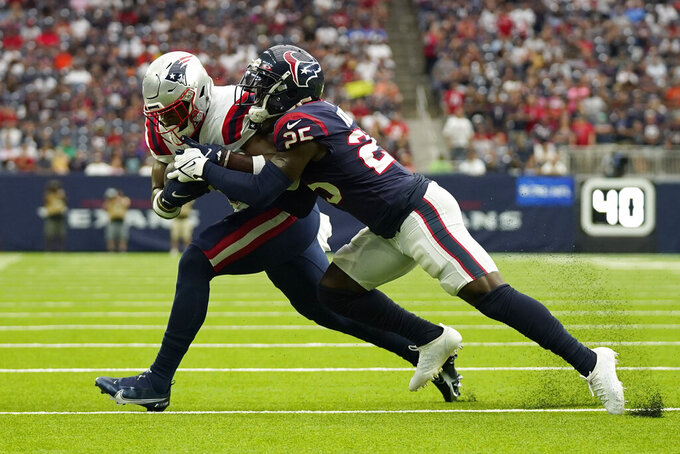 New England Patriots tight end Jonnu Smith (81) is tackled by Houston Texans cornerback Desmond King II (25) during the first half of an NFL football game Sunday, Oct. 10, 2021, in Houston. (AP Photo/Eric Christian Smith)
