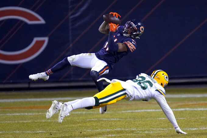 Chicago Bears' Darnell Mooney catches a pass in front of Green Bay Packers' Darnell Savage during the second half of an NFL football game Sunday, Jan. 3, 2021, in Chicago. (AP Photo/Charles Rex Arbogast)