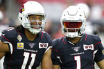 "Arizona Cardinals wide receiver Larry Fitzgerald (11) and quarterback Kyler Murray (1) wear a ""WVB"" patch in memory of the Cardinals' late owner William V. Bidwill prior to an NFL football game against the Atlanta Falcons, Sunday, Oct. 13, 2019, in Glendale, Ariz. (AP Photo/Ross D. Franklin)"