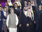 Saudi Arabia's Crown Prince Mohammed bin Salman, center right, is received by Indian Prime Minister Narendra Modi, center left, at the airport in New Delhi, India, Tuesday, Feb.19, 2019. Prince Mohammed arrived in India after visiting Pakistan, which New Delhi blames for a suicide bombing attack last week that killed at least 40 Indian soldiers in disputed Kashmir. (AP Photo/Manish Swarup)