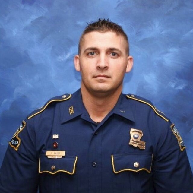 A photo provided by the Louisiana State Police shows Trooper George Baker, 33, who died Sunday, May 24, 2020, days after he was struck by another law enforcement vehicle as he aided in a pursuit of two suspects. (Louisiana State Police via AP)