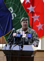 """U.S. Army Gen. Scott Miller, the top U.S. commander in Afghanistan, speaks at a ceremony where he relinquished his command, at Resolute Support headquarters, in Kabul, Afghanistan, Monday, July 12, 2021. The United States is a step closer to ending a 20-year military presence that became known as its """"forever war,"""" as Taliban insurgents continue to gain territory across the country. (AP Photo/Ahmad Seir)"""