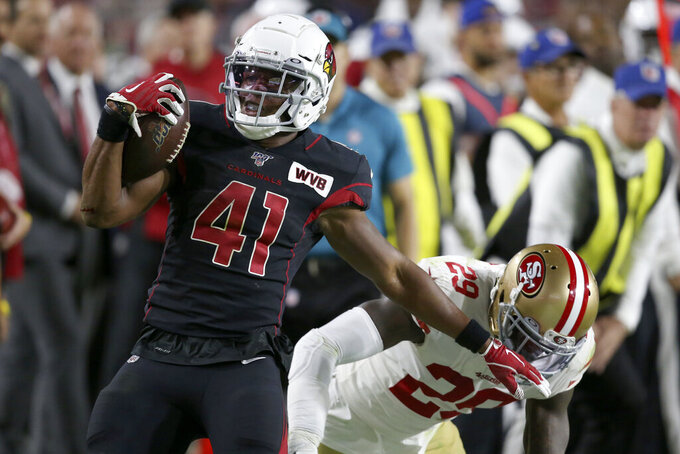 Arizona Cardinals running back Kenyan Drake (41) is hit by San Francisco 49ers strong safety Jaquiski Tartt (29) during the second half of an NFL football game, Thursday, Oct. 31, 2019, in Glendale, Ariz. (AP Photo/Ross D. Franklin)
