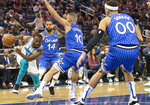Charlotte Hornets guard Kemba Walker (15) dribbles against Orlando Magic guard D.J. Augustin (14), guard Evan Fournier (10) and forward Aaron Gordon (00) during the first half of an NBA basketball game in Orlando, Fla., Thursday, Feb. 14, 2019. (AP Photo/Willie J. Allen Jr.)