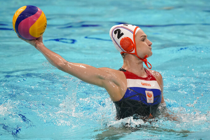 Netherland's Maud Megens shoots against Spain during a preliminary round women's water polo match at the 2020 Summer Olympics, Wednesday, July 28, 2021, in Tokyo, Japan. (AP Photo/Mark Humphrey)
