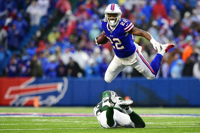 Buffalo Bills running back T.J. Yeldon (22) hurdles New York Jets strong safety Jamal Adams, bottom, during the second half of an NFL football game Sunday, Dec. 29, 2019, in Orchard Park, N.Y. (AP Photo/David Dermer)