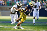 Notre Dame running back Kyren Williams (23) breaks the tackle of Purdue linebacker Jalen Graham (6) on his way to a touchdown during the second half of an NCAA college football game in South Bend, Ind., Saturday, Sept. 18, 2021. Notre Dame defeated Purdue 27-13. (AP Photo/Michael Conroy)