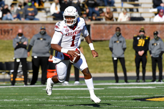 FILE - Arkansas quarterback K.J. Jefferson scrambles during the first half of an NCAA college football game against Missouri, in Columbia, Mo., in this Saturday, Dec. 5, 2020, file photo. Junior Jefferson will start for just the second time in his career. (AP Photo/L.G. Patterson, File)