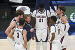 Gonzaga coach Mark Few talks with the team during a timeout in the first half of an NCAA college basketball game against West Virginia, Wednesday, Dec. 2, 2020, in Indianapolis. (AP Photo/Darron Cummings)