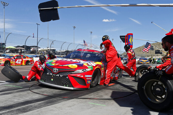 Driver Kyle Busch makes a pit stop during lap 153 of the NASCAR Cup Series auto race at ISM Raceway, Sunday, March 10, 2019, in Avondale, Ariz. (AP Photo/Ralph Freso)