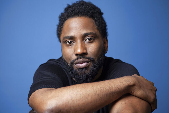 FILE - In this Nov. 14, 2018 photo, actor John David Washington poses for a portrait at the Four Seasons Hotel in Los Angeles. Washington stars in the Christopher Nolan film