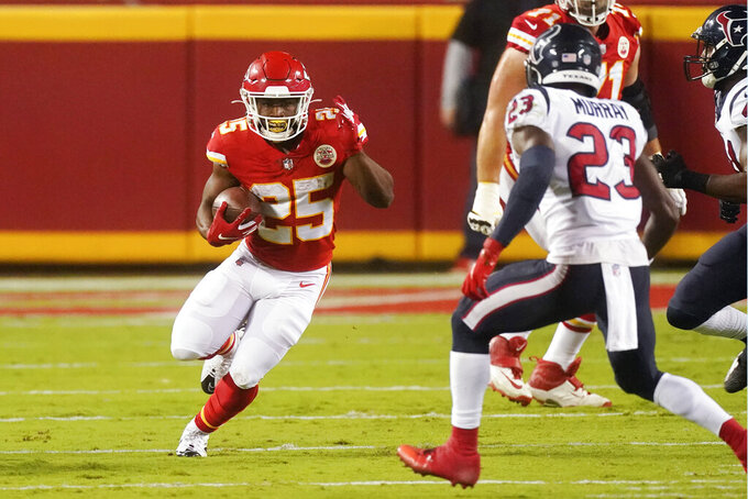 Kansas City Chiefs running back Clyde Edwards-Helaire (25) carries the ball against Houston Texans safety Eric Murray (23) in the first half of an NFL football game Thursday, Sept. 10, 2020, in Kansas City, Mo. (AP Photo/Charlie Riedel)