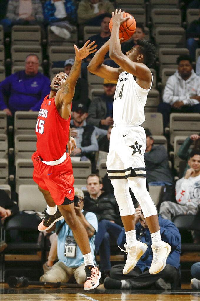 Vanderbilt forward Aaron Nesmith (24) shoots over the reach of SMU forward Isiaha Mike (15) during the first half of an NCAA college basketball game Saturday, Jan. 4, 2020, in Nashville, Tenn. (AP Photo/Mark Humphrey)