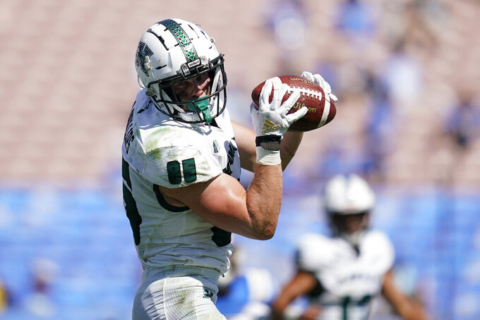 Hawaii tight end Caleb Phillips catches a pass before landing in the end zone for a touchdown during the second half of an NCAA college football game against UCLA Saturday, Aug. 28, 2021, in Pasadena, Calif. (AP Photo/Ashley Landis)