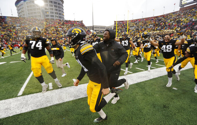Iowa placekicker Miguel Recinos, center, celebrates with teammates after making a 41-yard field goal on the final play of an NCAA college football game against Nebraska, Friday, Nov. 23, 2018, in Iowa City, Iowa. (AP Photo/Charlie Neibergall)