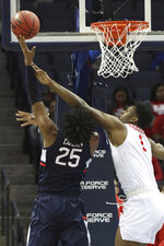 Houston's Chris Harris Jr., right, defends as Connecticut's Josh Carlton shoots in the first half during the first half of an NCAA college basketball game against Houston at the American Athletic Conference tournament Friday, March 15, 2019, in Memphis, Tenn. (AP Photo/Troy Glasgow)