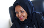 FILE - In this Jan. 5, 2017, file photo, state Rep. Ilhan Omar is interviewed in her office two days after the 2017 Legislature convened in St. Paul, Minn. Somali-American legislator Ilhan Omar made history Tuesday, Aug. 14, 2018, by winning the Democratic congressional primary in a Minneapolis-area district so reliably liberal that her victory is likely her ticket to Congress. (AP Photo/Jim Monem File)