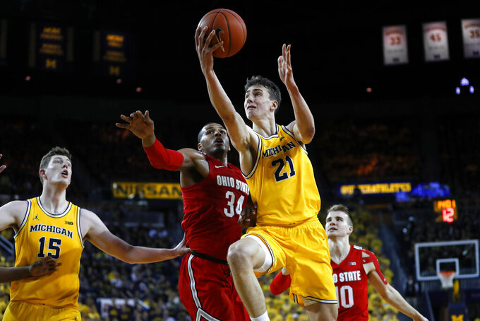 Michigan guard Franz Wagner (21) drives on Ohio State forward Kaleb Wesson (34) in the second half of an NCAA college basketball game in Ann Arbor, Mich., Tuesday, Feb. 4, 2020. (AP Photo/Paul Sancya)