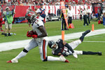 Tampa Bay Buccaneers wide receiver Chris Godwin (14) beats Atlanta Falcons cornerback Isaiah Oliver (26) on a 12-yard touchdown reception during the second half of an NFL football game Sunday, Sept. 19, 2021, in Tampa, Fla. (AP Photo/Jason Behnken)