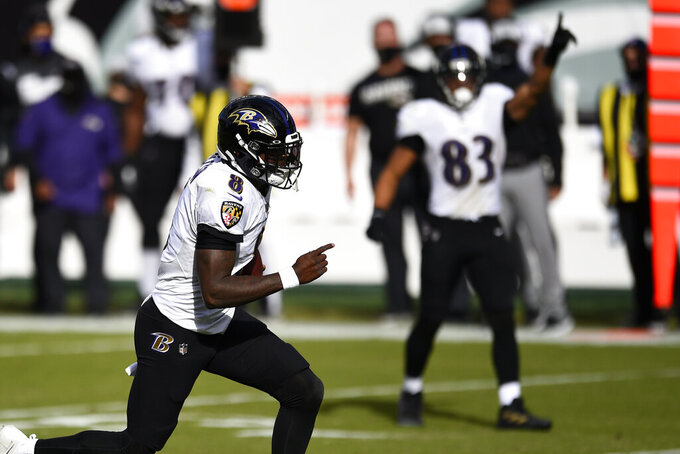 Baltimore Ravens' Lamar Jackson (8) runs for a touchdown during the second half of an NFL football game against the Philadelphia Eagles, Sunday, Oct. 18, 2020, in Philadelphia. (AP Photo/Derik Hamilton)
