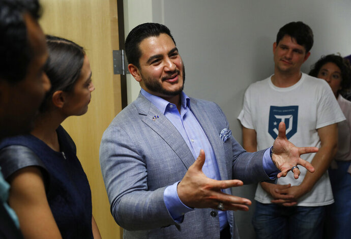 """FILE - In this July 28, 2018 file photo, former Michigan Democratic gubernatorial candidate Abdul El-Sayed speaks to U.S. Rep. Alexandria Ocasio-Cortez, D-N.Y., left, and other supporters during a campaign stop in Detroit. Since the 2016 elections, more """"Muslims recognized that every vote that we make is a down payment on the attention that every politician will have to pay to our community in the future,"""" El-Sayed said in a recent interview. (AP Photo/Paul Sancya, File)"""