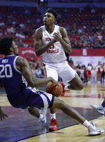 UNLV's Bryce Hamilton, right, drives into Kansas State's Xavier Sneed during the first half of an NCAA college basketball game Saturday, Nov. 9, 2019, in Las Vegas. (AP Photo/John Locher)