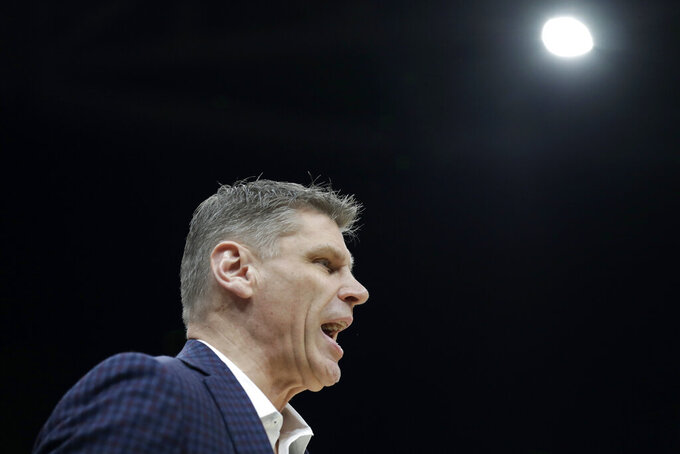 Loyola of Chicago head coach Porter Moser is seen on the sidelines during the first half of an NCAA college basketball game against Valparaiso in the quarterfinal round of the Missouri Valley Conference men's tournament Friday, March 6, 2020, in St. Louis. (AP Photo/Jeff Roberson)