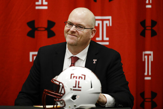 Incoming Temple head coach Rod Carey listens to his introduction during an NCAA college football news conference in Philadelphia, Friday, Jan. 11, 2019. (AP Photo/Matt Rourke)