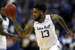 FILE - In this Feb. 2, 2020, file photo, Seton Hall guard Myles Powell (13) drives to the basket against Creighton during the second half of an NCAA college basketball game in Newark, N.J. Powell was selected to The Associated Press All-America first team, Friday, March 20, 2020. (AP Photo/Adam Hunger, File)