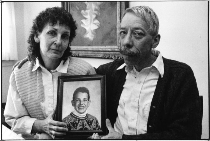 In this Jan. 7, 1992 photo, Esther and Allan Chereck, parents of slain David Chereck, hold a photo of their son during an interview at their home in Skokie, Ill.  on Jan. 7, 1992. Eduardo Contreras,  Robert Serritella was found guilty Thursday, May 23, 2019 of first-degree murder in the 1992 death of 15-year-old David Chereck.  Serritella, 76, of Park Ridge, was charged in 2014 in the decades-old cold case. Chereck was found strangled with his own scarf in a Morton Grove forest preserve.  (Eduardo Contreras/Chicago Tribune via AP)